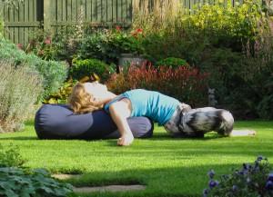 Reclining backbend yin yoga pose